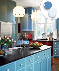 golden yellow painted cabinets blue walls