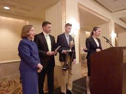 trinity student wins national financial essay award   washington        moment   instructor janice kuhn  left  his father  jeff  and melanie mortimer  president of sifma foundation  owner of the stock market game program