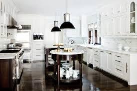 beautiful white kitchen cabinets: beautiful white and espresso kitchen glossy espresso wood floors white kitchen cabinets white carrara marble countertops and black pendant