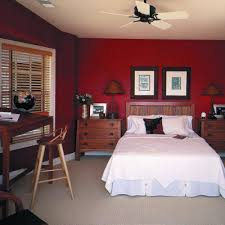 red wall paint black bed: most wood colors do not look good next to a red wall this wall color is making the furniture look bad i would have kept the red just in the accents