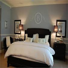 monogrammed wall decal blue walls brown furniture