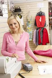 female s assistant in clothing store stock photo picture and female s assistant in clothing store stock photo 5633240