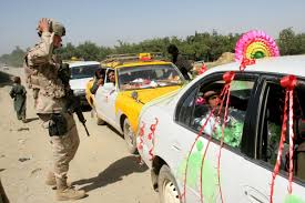 photo essay years of war warrior scout a us ier inspects a wedding car at a checkpoint in a crossroad near bagram air base and detention center north of kabul tuesday 12