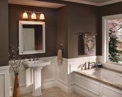 3 lights brushed nickel sconces above bathroom vanity mirror and porcelain pedestal sink large above mirror lighting bathrooms