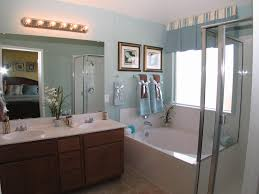 bathroom features gray shaker vanity:  ideas about white vanity bathroom on pinterest white vanity shower trays and bathroom sconces