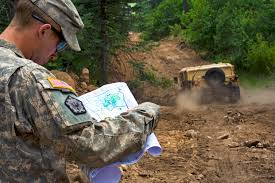 u s department of defense photo essay u s army 1st lt cameron rohrer checks a map to see where to build a