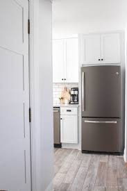 black appliance matte seamless kitchen: this indiana farmhouse just got a big kitchen makeover click to see more photos and