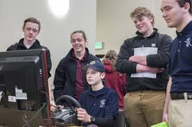 from police dogs to firefighter gear teens get up close view of nick agy uses a driving simulator during criminal justice career day for teens in muskegon on thursday 30 2017