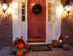 orange green pumpkins on the brown floor feat wooden door f brick wall shutter designs exterior child friendly halloween lighting inmyinterior outdoor
