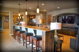 basement man cave with large bar counter behind the tv viewing area basement sports bar ideas