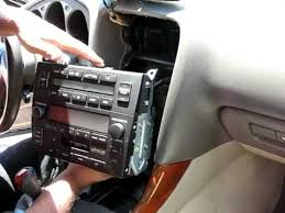how to install an aftermarket radio in lexus es club 4 there will be a bracket on the side that connects the climate control and the stock radio together unscrew all screws your phillips head