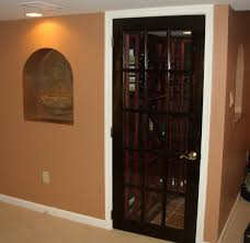 under the basement stairs wine cellar with stained french door and basement wine cellar idea
