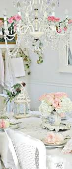 shabby chic style dining room with crystal chandelier and fresh flowers arrangements beautiful shabby chic style