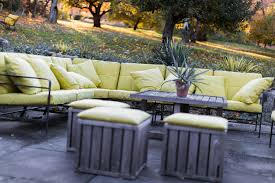 gallery outdoor living wall featuring:  sofa on outdoor patio featuring cushions with green sunbrella fabric
