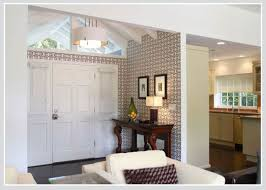 zones bedroom wallpaper: while connecting to the same wallpaper in the kitchen the larger scale feature wall defines a more relaxed resting zone that also separates it from the