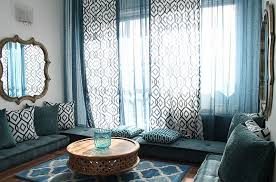 living room mattress: living room blue moroccan design ideas with round beige varnished woood table also wood mirror wall collage and brown wooden laminate flooring besides