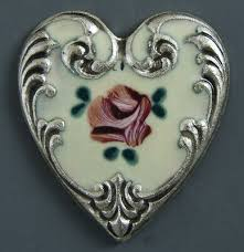 <b>heart shaped</b>, hand-painted <b>metal</b> button with <b>floral design</b>