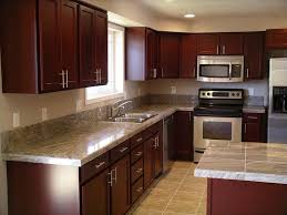 in style kitchen cabinets: cherry kitchen cabinets with marble countertop in simple design for modern style kitchen decoration