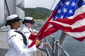 u s department of > photos > photo gallery navy petty officers 3rd class alana marshall and lacey acosta hoist the national flag as the