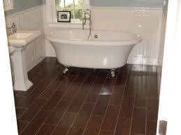 ceramic tile for bathroom floors: gorgeous wood look tile floors for inspiring bathroom flooring with unique white bathtubs stainless legs also