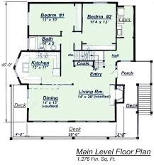 Chalet House Plan Model C Lower Floor Plan from Creative House    Areas colored in green represent living space areas of this chalet style home   Overlooks are represented by white areas