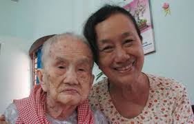 Nguyen Thi Lanh, 106, and her youngest daughter, 71, from HCMC's District 12. She and her husband, Huynh Van Lac, 110, have been certified by Vietnam ... - nguyen-thi-lanh-106-and-her-youngest-daughter-71-from-hcmcs-district-12-she-and-her-husband-huynh-van-lac-110-have-been-certified-by-vietnam-records-book-as-the-countrys-oldest-couple-703213-longevity
