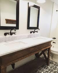 custom made reclaimed barn wood bath vanity with marble counter top on cement tile flooring bathroom vanity lighting remodel custom
