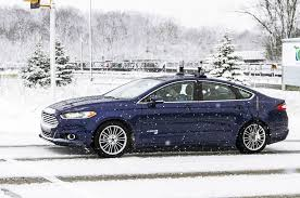 testing semi autonomous cars tesla cadillac hyundai and autonomous testing 2016 ford fusion hybrid side profile in snow