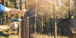 Fencing - worker installing metal <b>wire mesh fence</b> panel Image ...