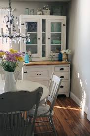 rustic hutch dining room:  vintage hutch is an absolute space saver in the small shabby chic style dining room