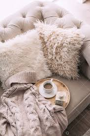 Still life details of <b>nordic living room</b>. Coffee and sweater on the sofa ...