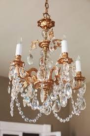 amelie entrance halls and hall bathroom on pinterest amelie distressed chandelier perfect lighting