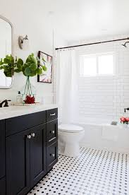 black and white bathroom with subway tile shower interesting tile detail around window black and white bathroom furniture