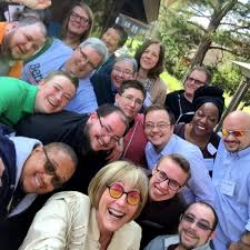 transgender identity inclusion and resources org more than a dozen uu religious professionals who are transgender smile during a retreat