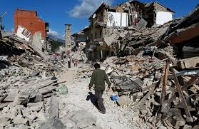 photos rescuers survivors after earthquake in pbs a man walks through the rubble following a 6 2 magnitude earthquake in pescara del tronto