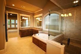 cozy oval bathtub and glass shower door design feat corner vanity idea in compact master bathroom bathroom track lighting master bathroom ideas