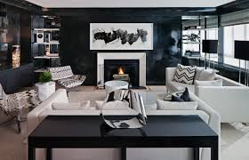 haus interior living room black lacquer glossy wall paint chevron pillows upholstered lounge chairs white sofas fireplace modern art 2 black lacquer furniture paint