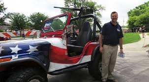 Kobach won't <b>apologize for</b> use of <b>Jeep</b>, replica gun in Shawnee ...