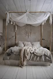 shabby chic furniture boho style bedroom bamboo four poster bed sheepskin knitted rug floorboards boho style furniture