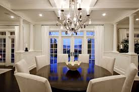 dining table parson chairs interior: chic elegant dining room design with glossy wood round pedestal dining table gray parsons chairs chandelier french doors transom windows and white