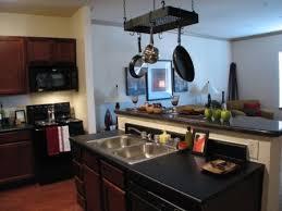 black appliance matte seamless kitchen: optimize minimalist concept with black kitchen design minimalist design kitchen black appliances with double sink