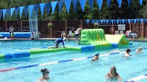 A portion of the <b>inflatable</b> obstacle course-huge hit with <b>kids</b> and <b>adults</b>