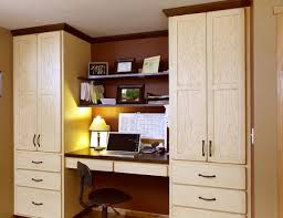 view in gallery cozy office space nestled between large red oak showplace cabinets 20 home office design ideas for cabinet home office design