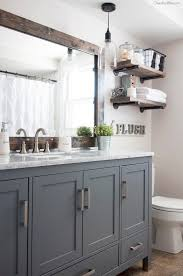 country themed reclaimed wood bathroom storage: pretty much the idea i have for the kids bathroom grey cabinets pipe wood shelves reframe the huge mirror paint walls soft white