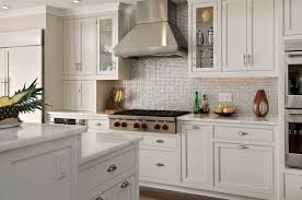 kitchen backsplash stainless steel tiles: fantastic contemporary kitchen design with small silver iridescent tile backsplash white kitchen cabinets amp kitchen island with marble countertops