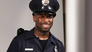 men try on a police uniform
