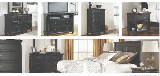 with the clean black finish beautifully accenting the stylish cottage design the owingsville bedroom set by signature design by ashley furniture creates an ashley furniture bedroom photo 2