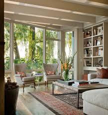 elegant kathy ireland furniture in living room traditional with beach living room furniture next to built in bookshelves alongside silk flower arrangement built furniture living room