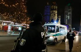 trump blames islamic terrorists for attacks in turkey and a german police officer secures the site of an accident a truck at a christmas