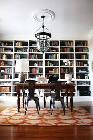 rustic office decor home office eclectic with wood flooring pendant lighting built in shelves black gloss rectangle home office